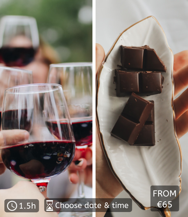 close up of red wine glasses clinking and chocolate